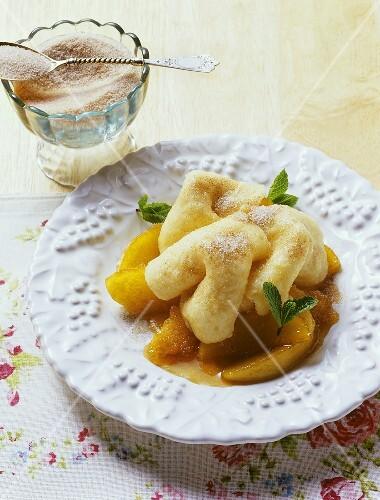 Rupfhauben (sweet, Bavarian pasta dough pastries) with apple sauce (Bavaria, Germany)