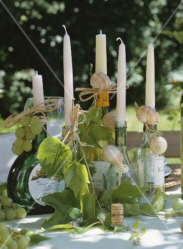 weinflaschen mit weinbl ttern dekoriert als kerzenhalter bild kaufen 382542 stockfood. Black Bedroom Furniture Sets. Home Design Ideas
