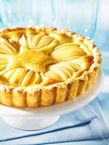 Pear and almond tart on a cake stand