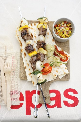 Grilled beef kebabs with tomato-mango salsa