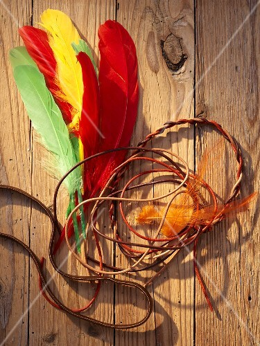 An Indian headdress with feathers and tassels as a prop for a Western-themed party