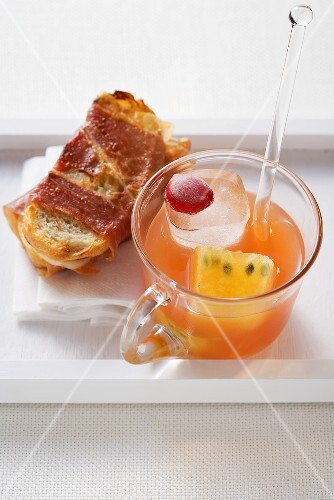 Passion fruit drink and a ham crostini