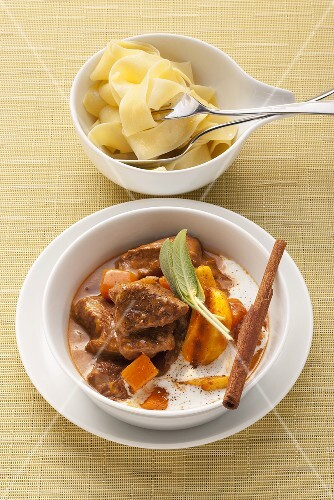 Creamy veal goulash in a pumpkin and apple sauce with cinnamon and tagliatelle