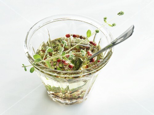 Grapeseed oil vinaigrette with pink pepper and herbs