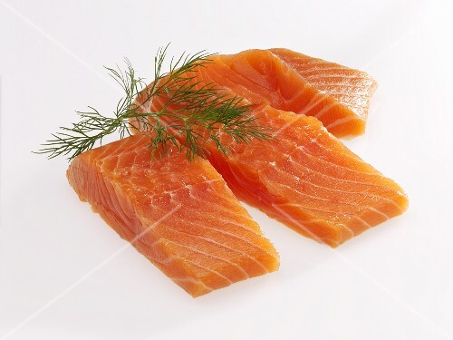 Raw salmon fillets with dill
