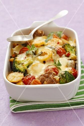 Broccoli and potato bake with tomatoes and meatballs