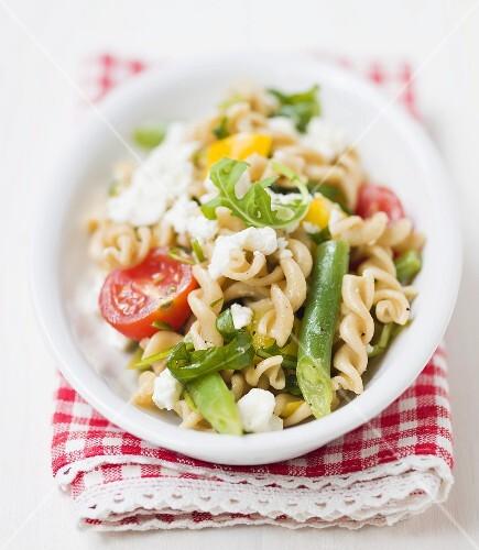 Pasta, bean, sheep's cheese and tomato salad
