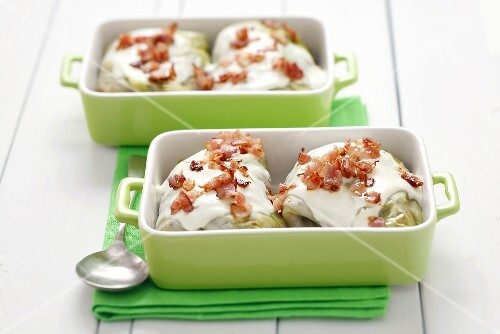 Stuffed cabbage leaves with buckwheat stuffing, sour cream, bacon
