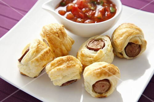 Sausage rolls and tomato sauce