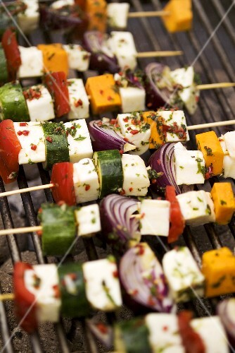 Cheese and vegetable kebabs on a barbecue
