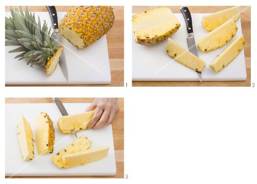 Cutting a pineapple into pieces