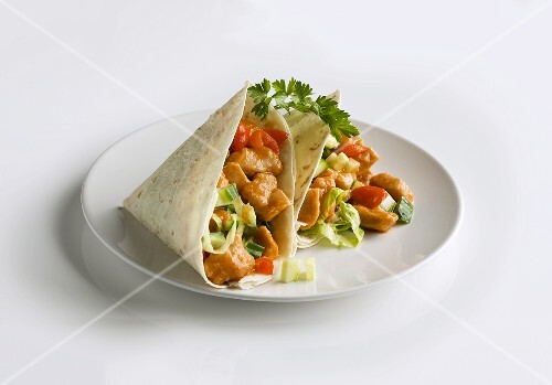 Two chicken wraps on plate