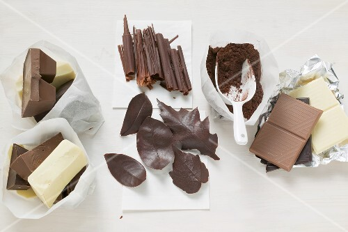 Dark, milk & white chocolate, cocoa, chocolate rolls & leaves