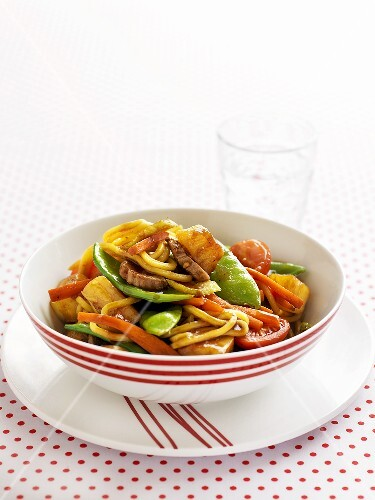 Sweet and sour pork with vegetables and noodles