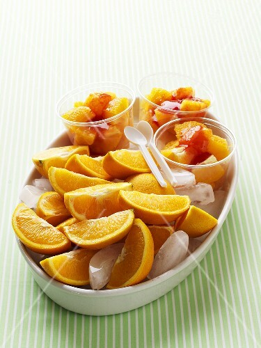 Orange wedges with strawberry sauce