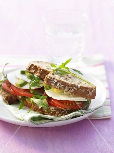 Tomato, mozzarella, avocado and rocket sandwich