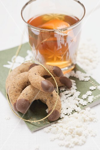 Chocolate crescents & glass of orange punch (Christmas)
