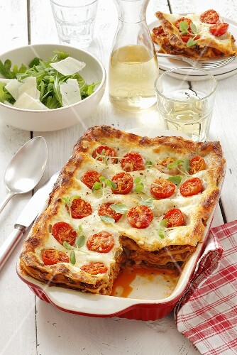 Lasagne with bolognese sauce and cocktail tomatoes