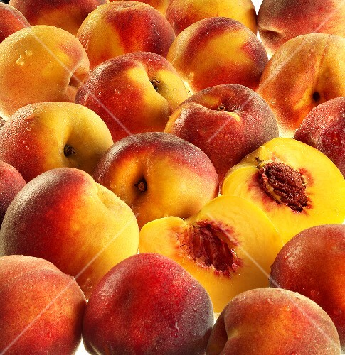 Freshly washed peaches, whole and halved
