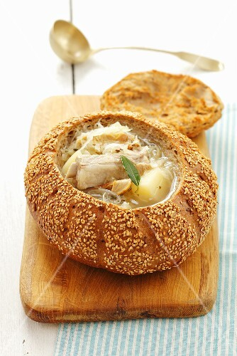 Sauerkraut soup with pork ribs served in hollowed out bread