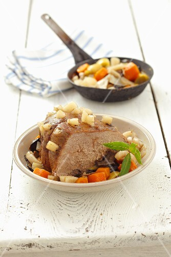 Braised beef peppered with bacon and vegetables (Poland)
