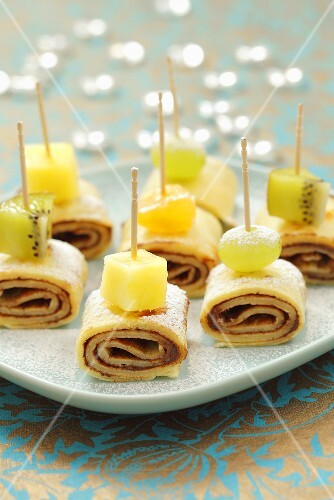 Pancake rolls filled with chocolate and topped with fruit