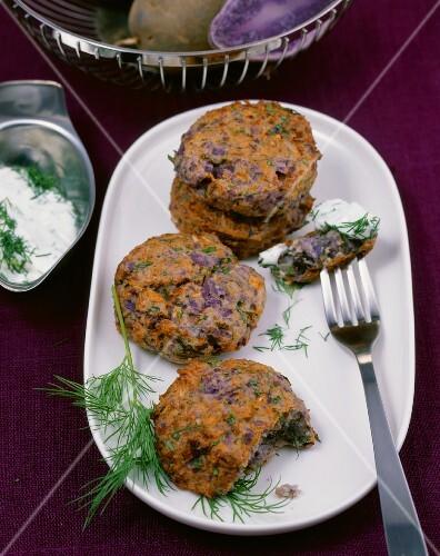 Purple potato cakes with a cream cheese dip