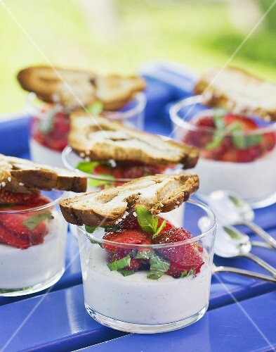 Panna cotta with strawberries and cinnamon cake in glasses
