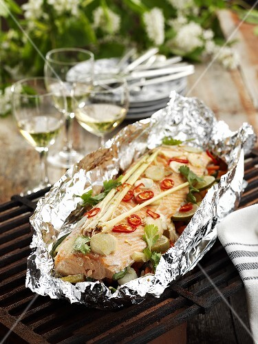 Salmon fillet with lemon grass & chilli in foil on barbecue