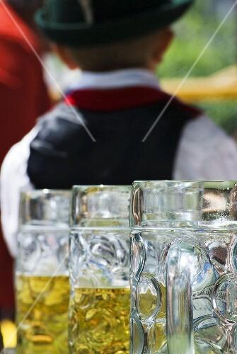 Tankards of beer in a beer garden