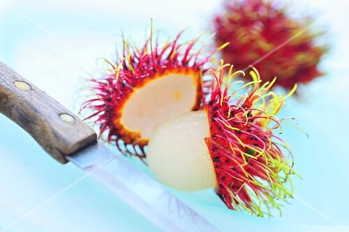 Rambutans, one peeled, one unpeeled