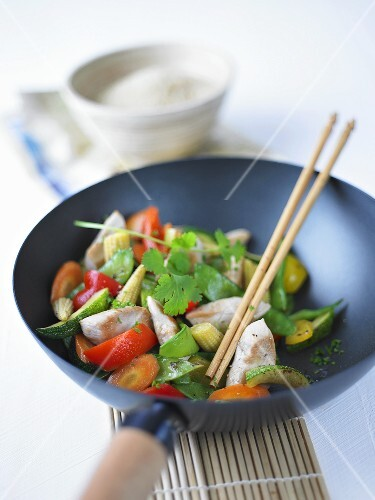 Meat, vegetables and fresh coriander in wok
