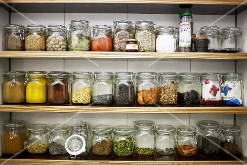 Spices in preserving jars on shelves