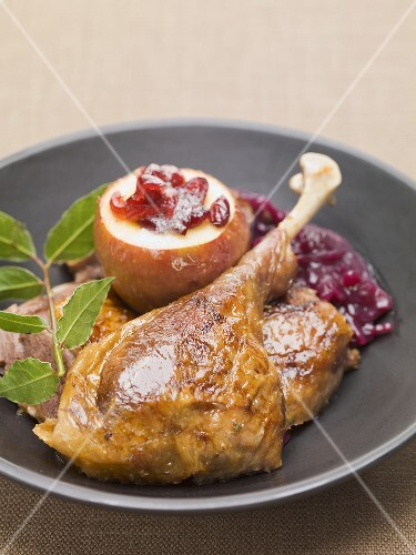 Roast duck with red cabbage and pear with cranberries