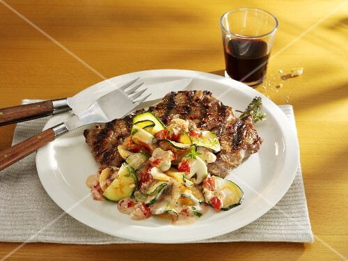Grilled chop with courgettes and tomatoes