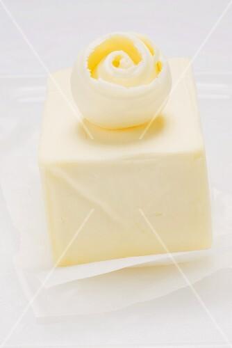 Butter curl on a block of butter