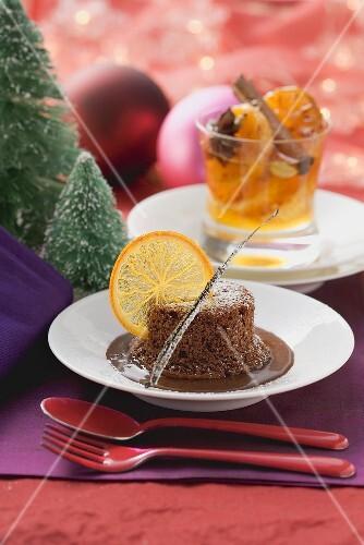Warm chocolate pudding with orange slices