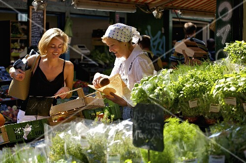 Blond woman shopping at a market