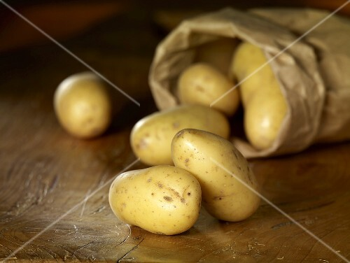 Potatoes (variety: Amandine) with paper bag