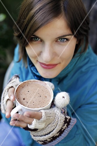 Young woman holding a cup of hot chocolate