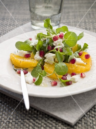Orange and watercress salad with pomegranate seeds and feta cheese