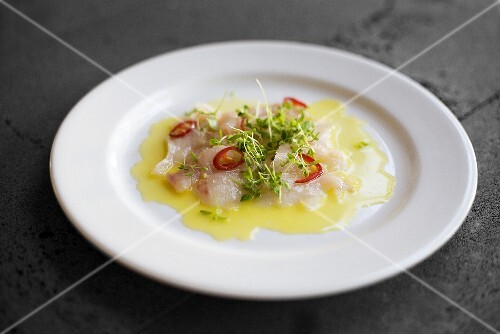 Fish carpaccio with chilli rings and cress