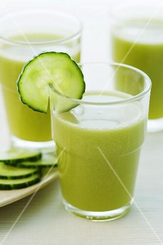 Three glasses of apple and cucumber juice
