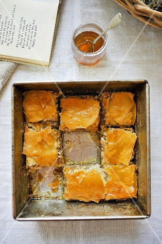 Puff pastry cake in a baking tin