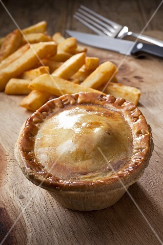 Steak and kidney pie with French fries (England)