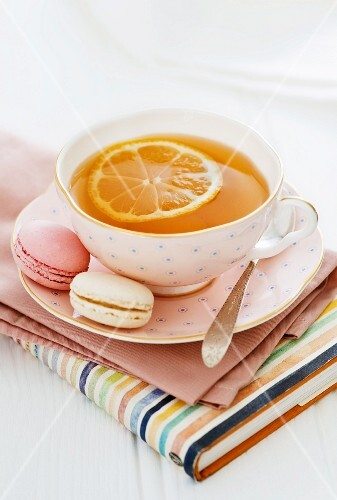 A cup of lemon tea and macaroons