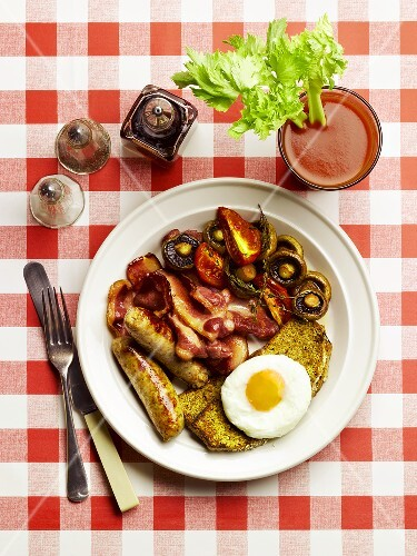 Hangover breakfast with egg, sausage, bacon, mushrooms and a Bloody Mary