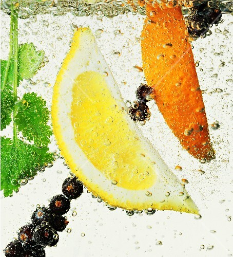 Citrus wedges and berries in water