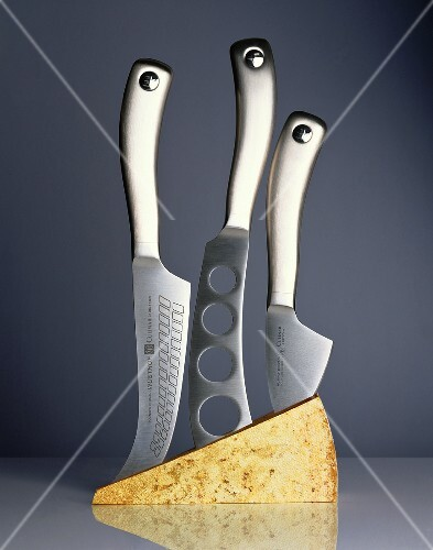 Three cheese knives in a block of cheese