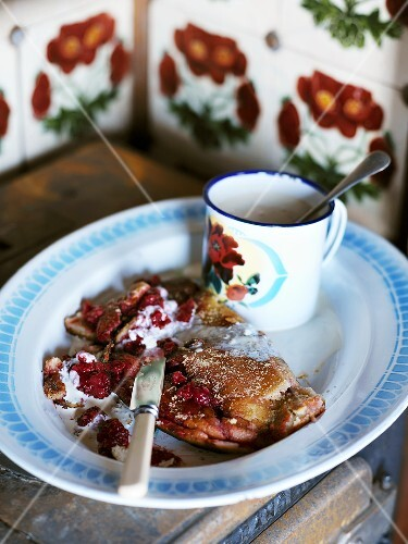 Berry pancake with a mug of hot milk